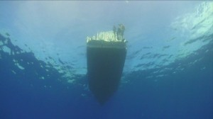 850850218-hull-ship-swimmer-deep-sea-diving-scuba-diving